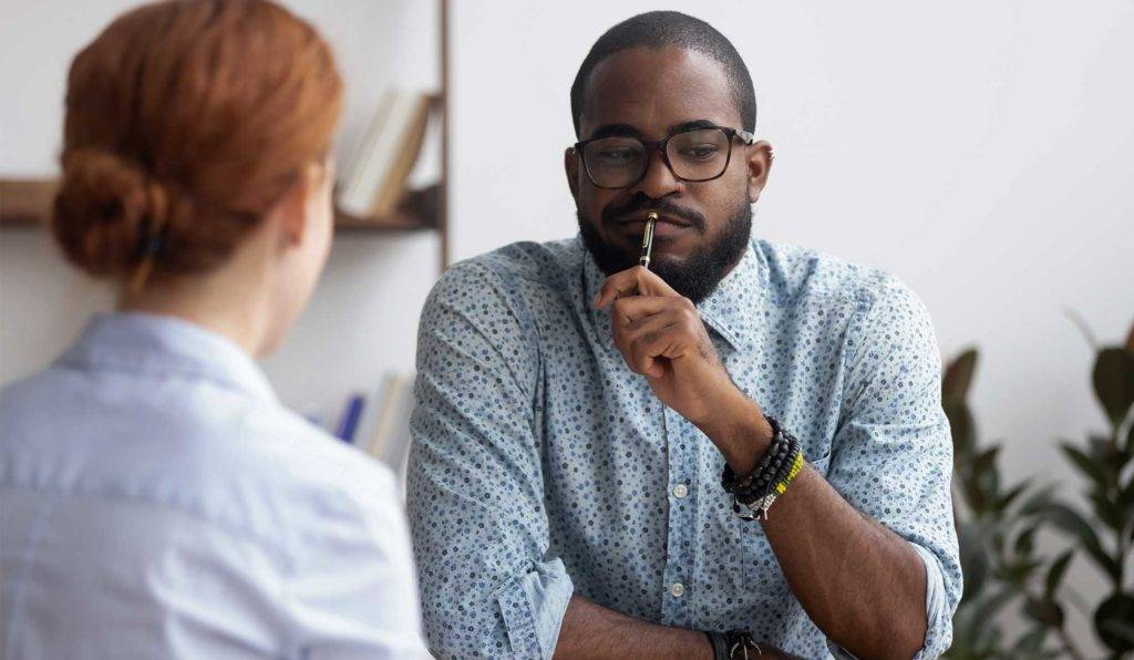 Two people in a job counteroffer negotiation